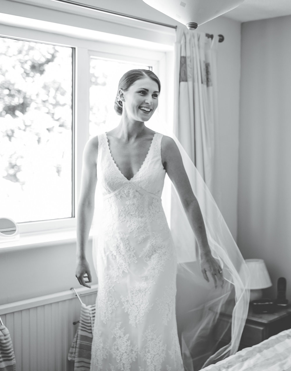 bride smiles as she sees herself for the first time