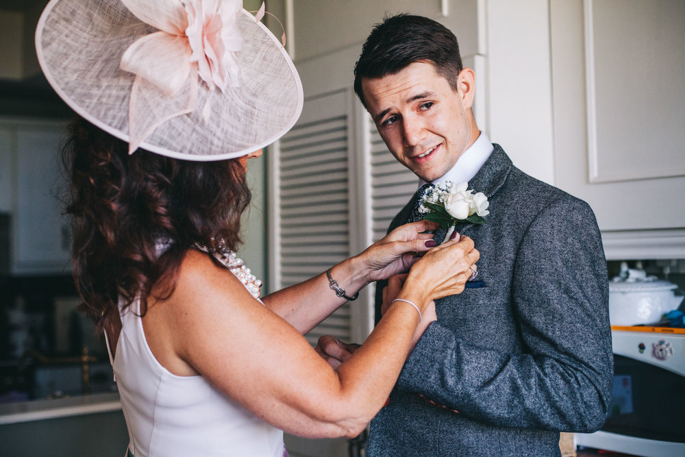 groom - getting his button hole on