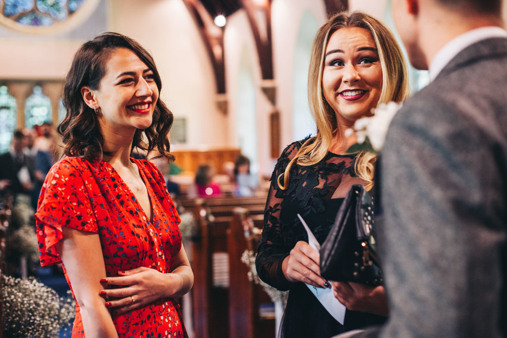 guests laughing in church