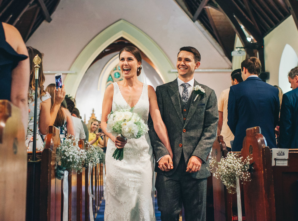walking down the aisle full of smiles - documentary wedding photography