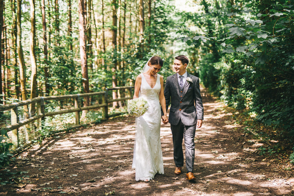 walking hand in hand - bride and groom portraits