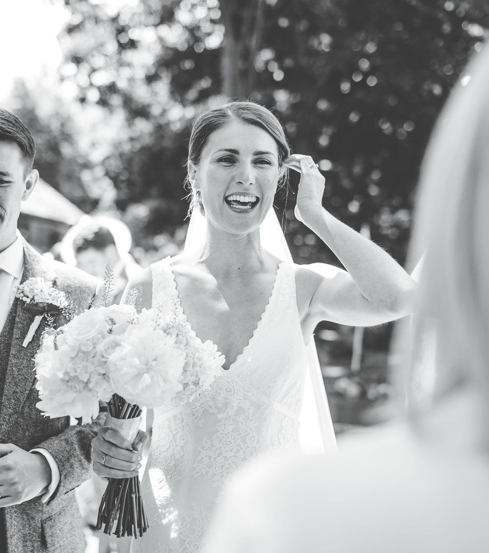 bride laughs - natural and relaxed wedding photography