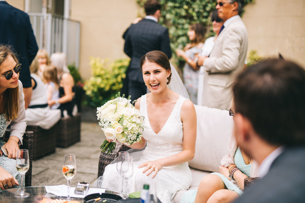 bride laughs with guests at West Tower Aughton wedding venue