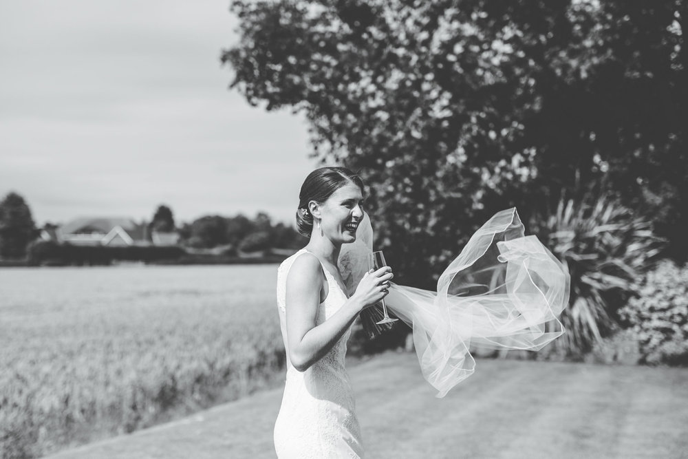 natural shot of the bride laughing at West Tower Aughton