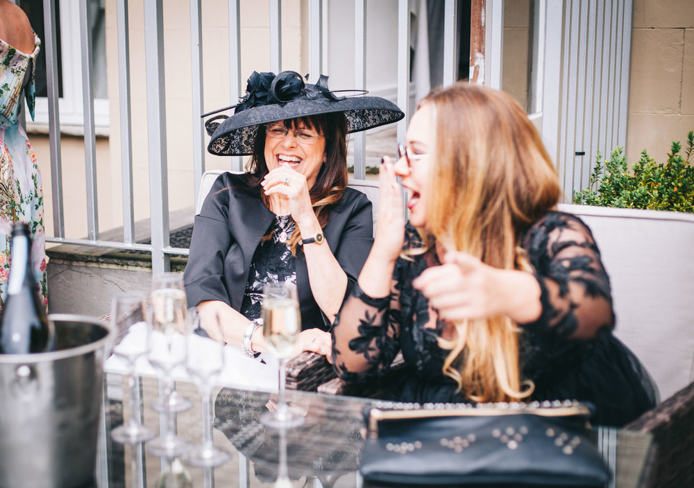 Wedding guests laugh with one another - documentary wedding photography lancashire