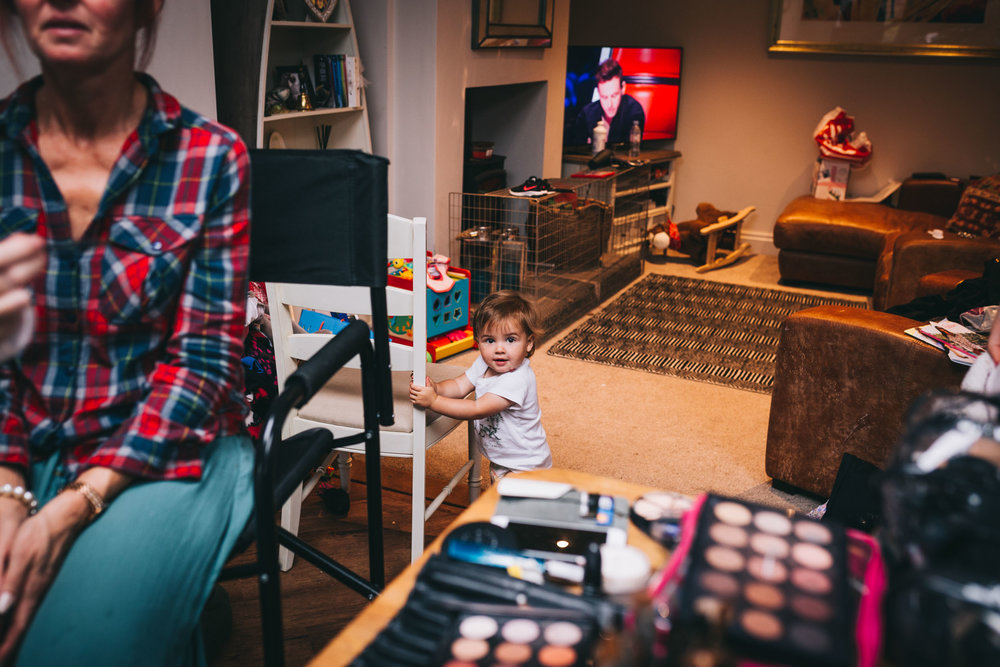 documentary  wedding pictures at Yorkshire wedding - baby in living room