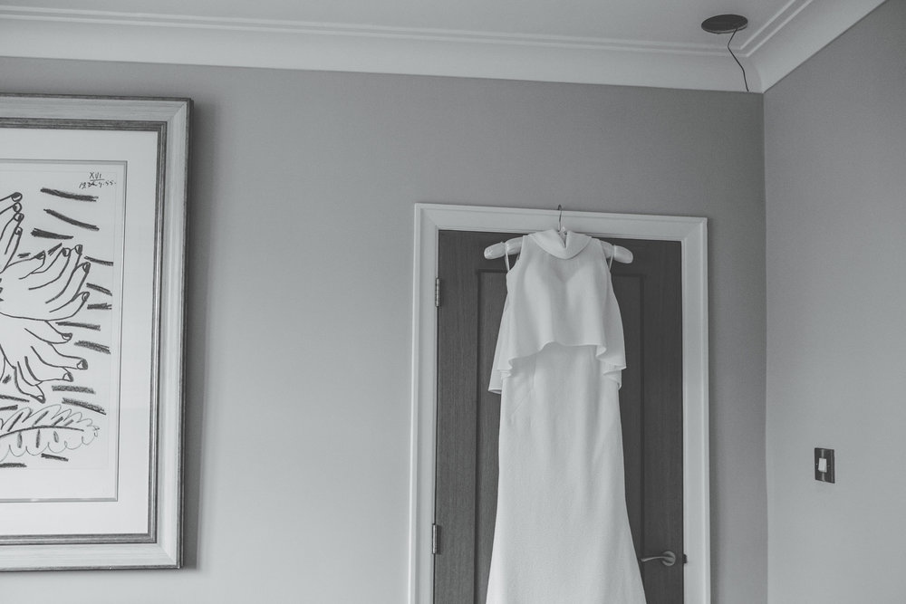 a gorgeous dress hanging up