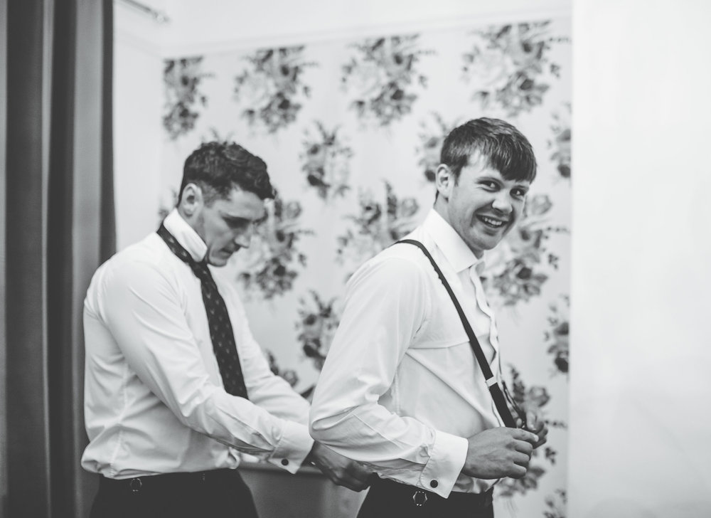 groom and best man getting ready - wedding photographer in the north west