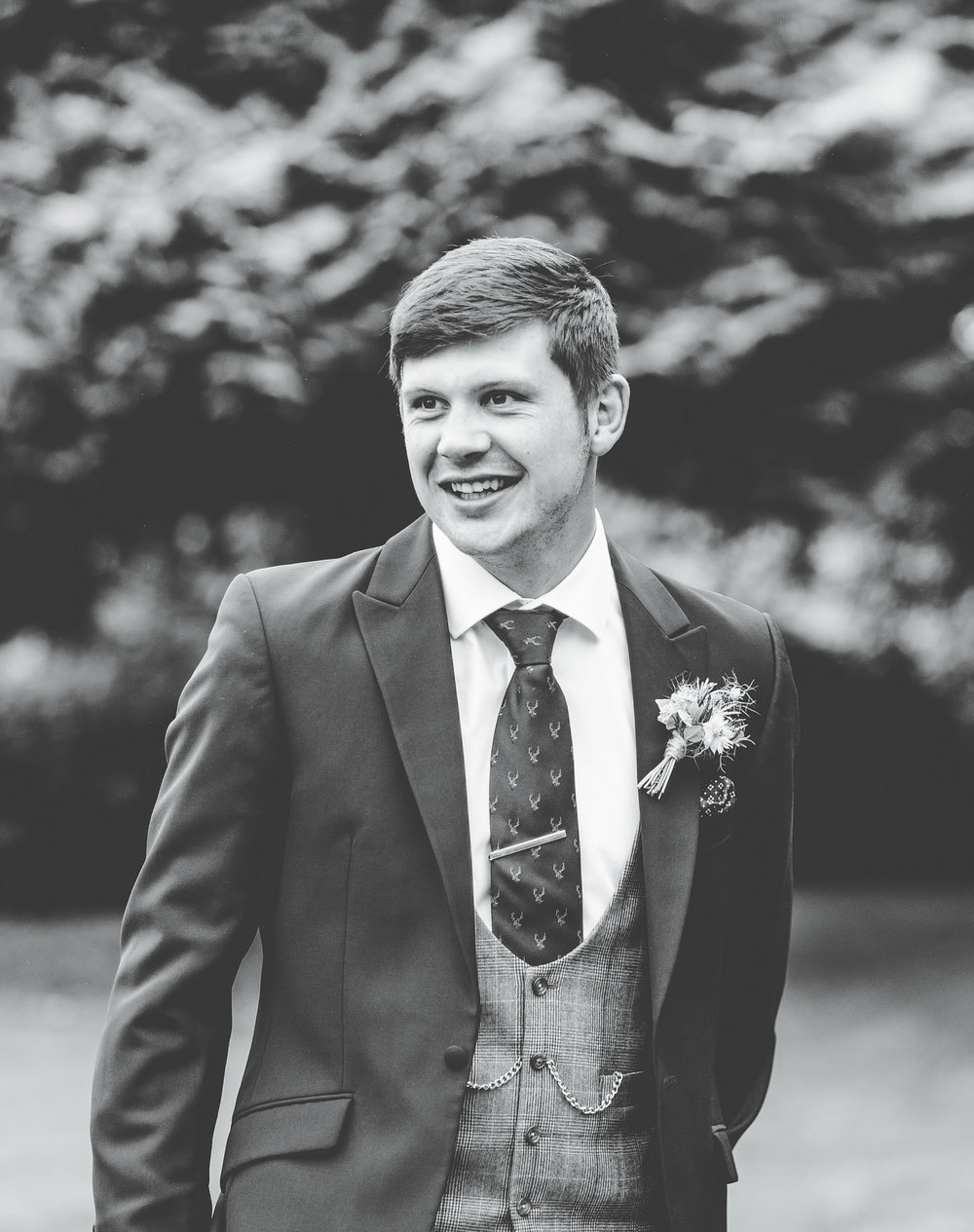 portrait of the groom waiting for his bride