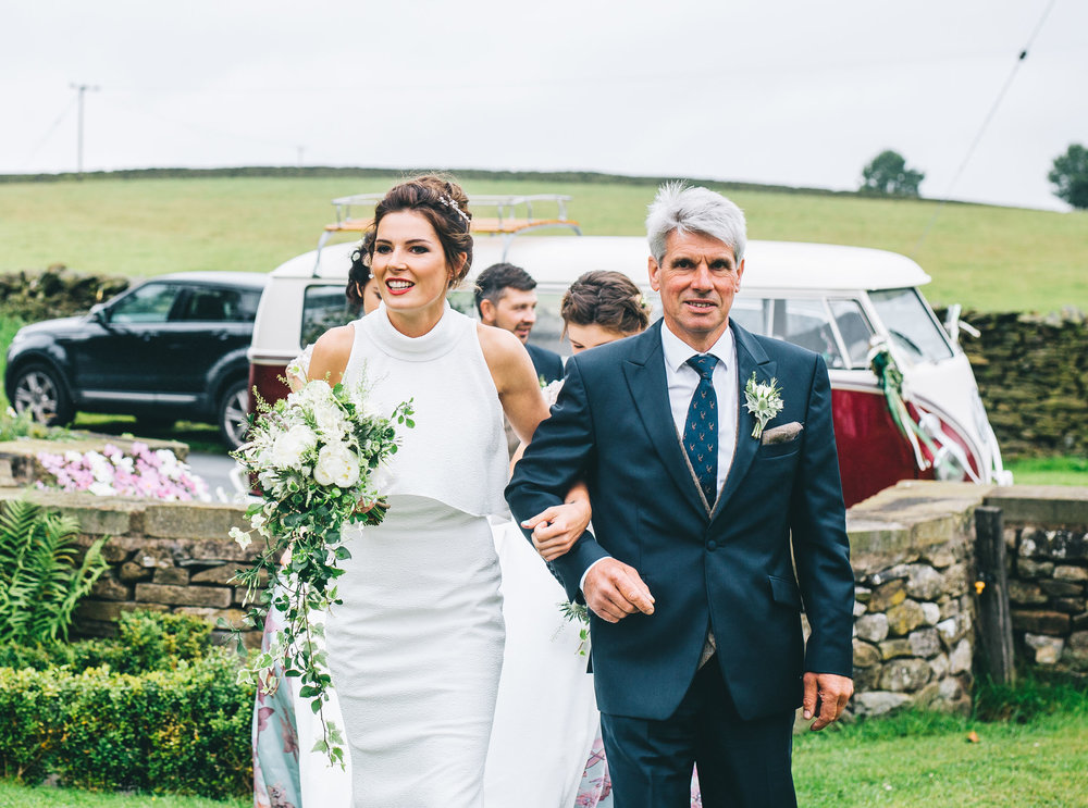 bride walks up to church - wedding photography in the north west
