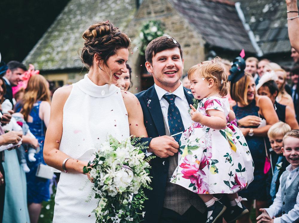 walking through the confetti - Yorkshire tipi wedding day