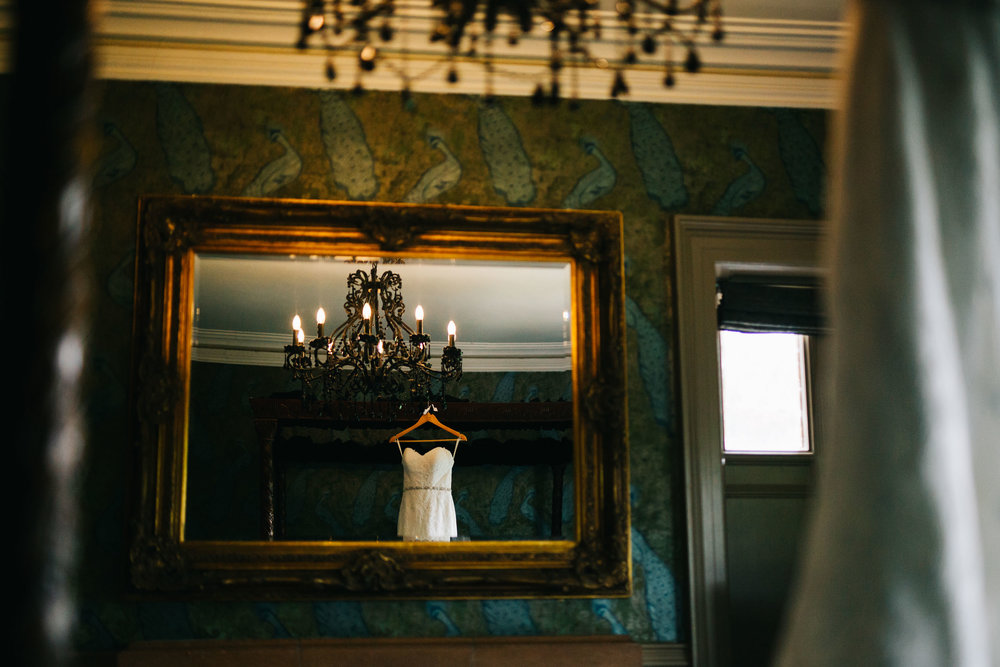 artistic wedding pictures - dress hanging up at Mitton Hall