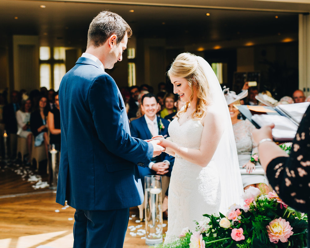 exchanging the rings - Mitton Hall wedding pictures
