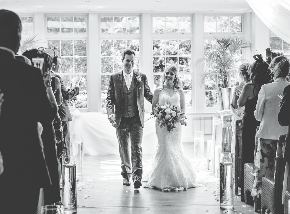 photography in lancashire - walking down the aisle as man and wife