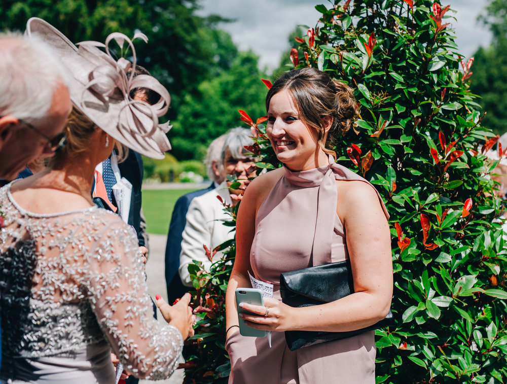 documentary images of the guests at summer Mitton Hall wedding