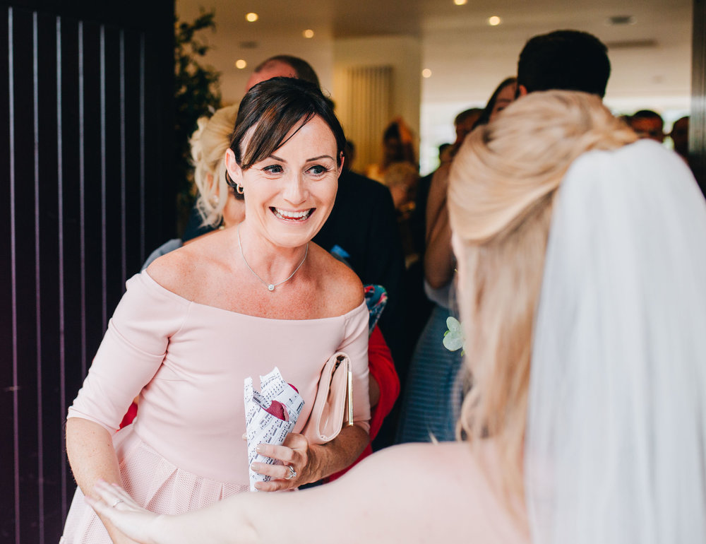 smiling and laughing guests enjoying the wedding day