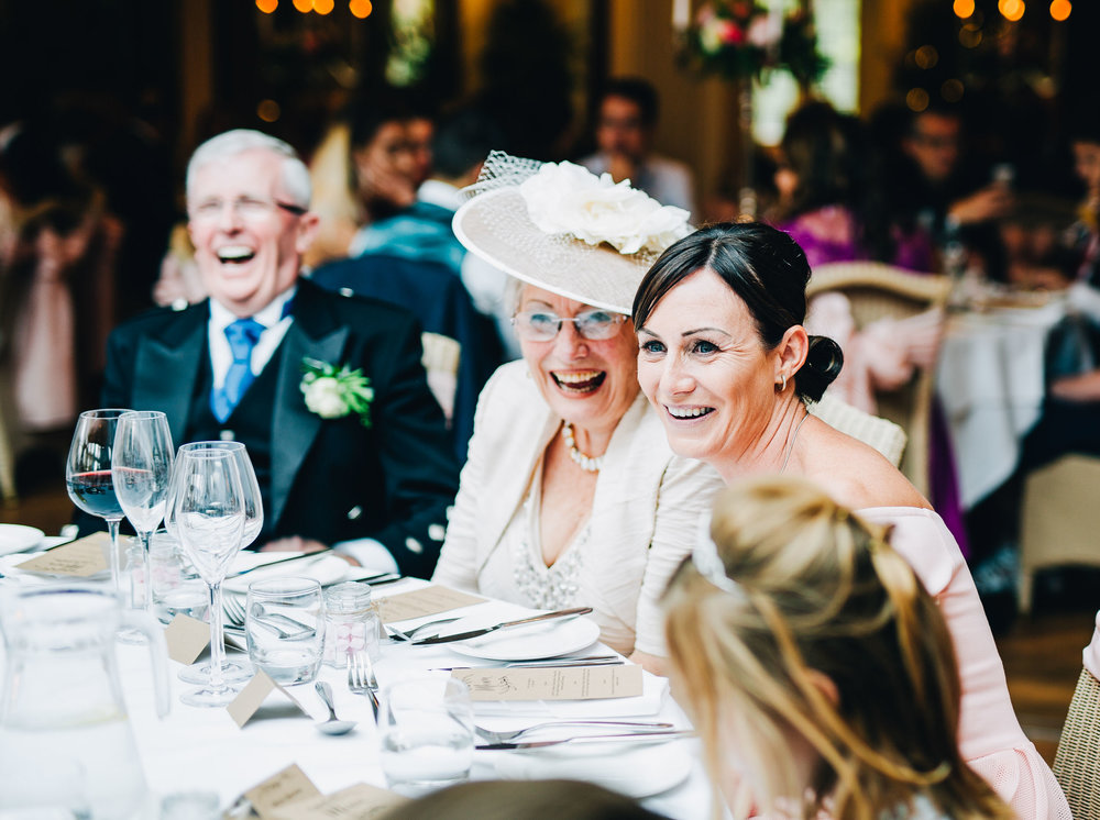 laughing guests at the wedding breakfast