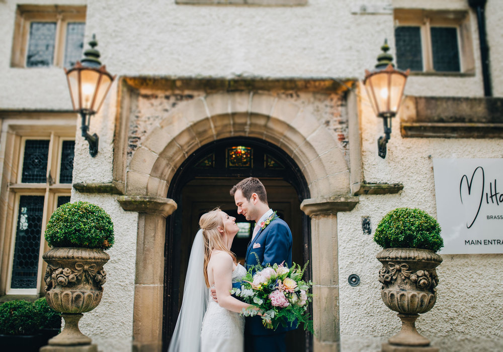 wedding pictures outside Mitton Hall - bride and groom