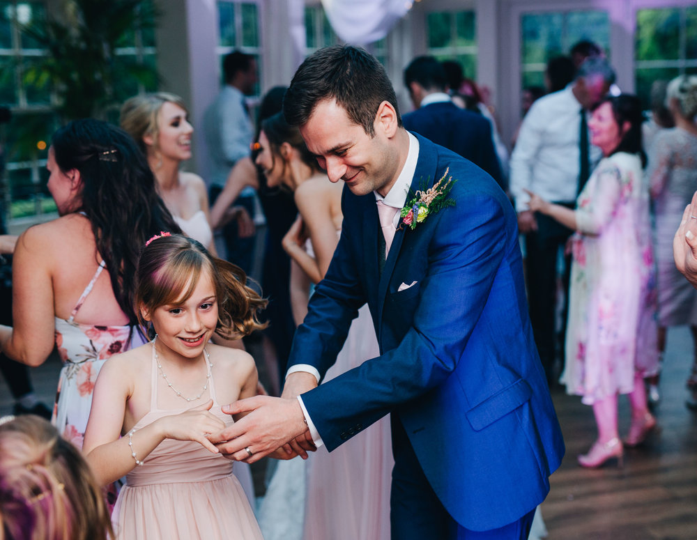 groom dances with the flower girl