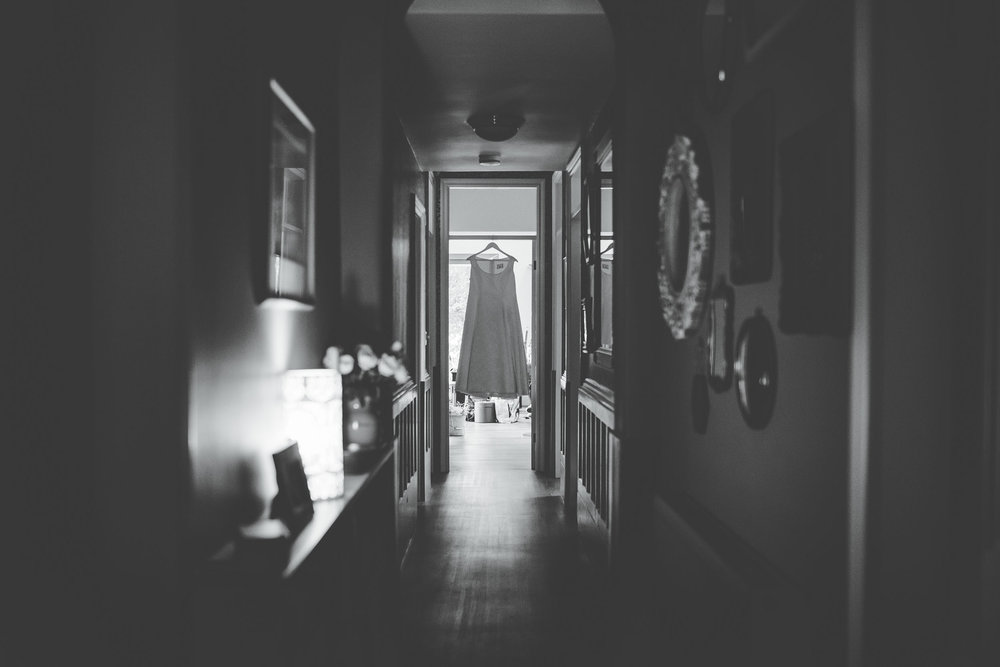 Lancashire wedding photography - dress hanging up in hallway