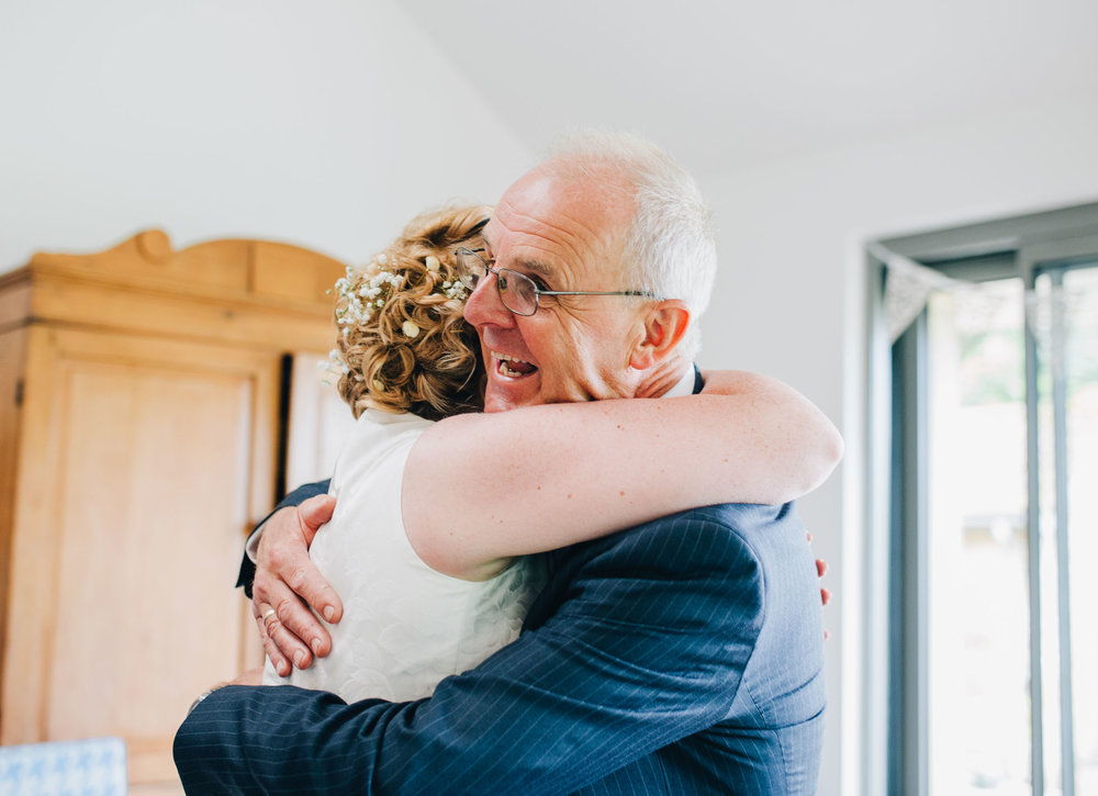 dad sees daughter for the first time - wedding photographer in lancashire