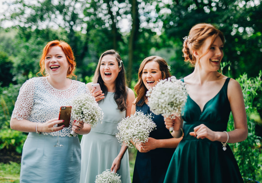 laughing bridesmaids - documentary natural wedding pictures
