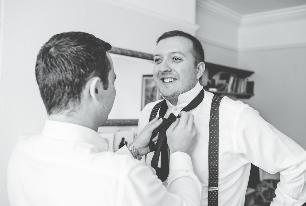groom getting his tie done - wedding photography lancashire