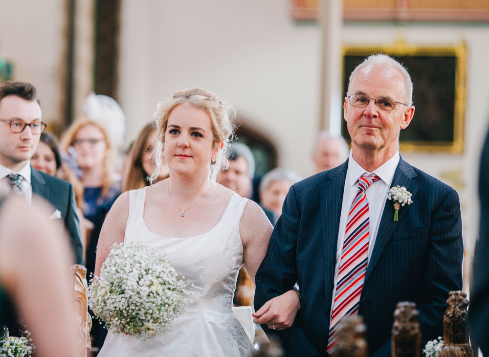 bride walking down the aisle with her dad - Ribble Valley wedding