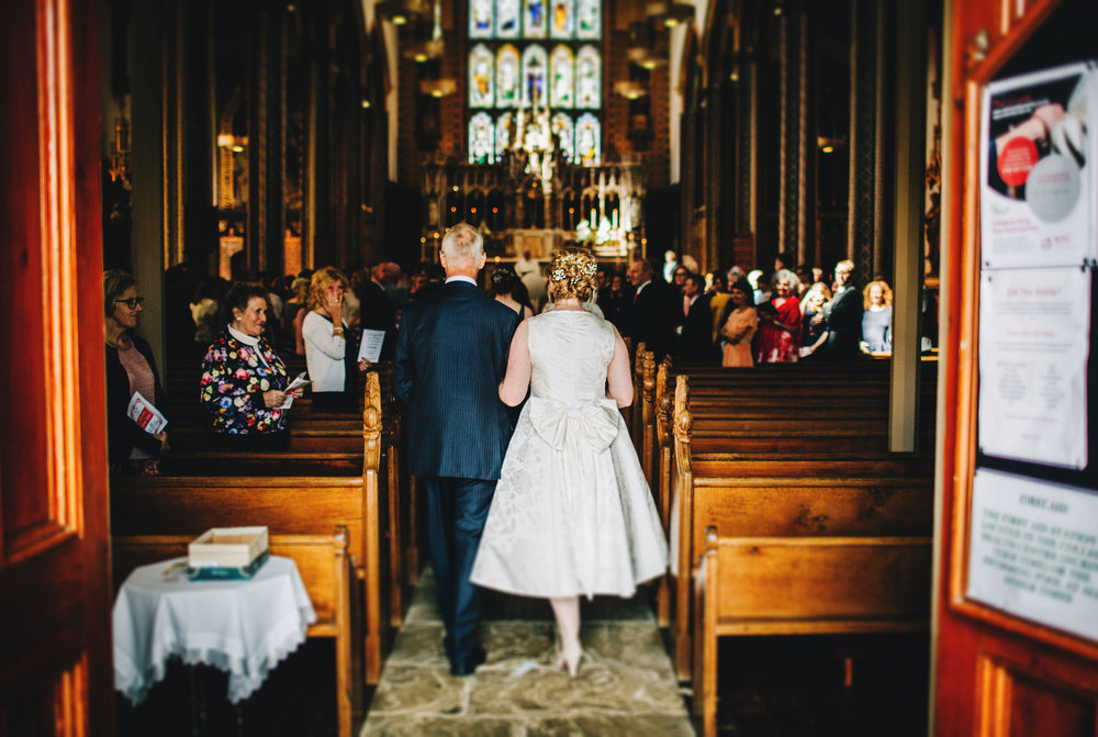 bride walks down the aisle at Stonyhurst college