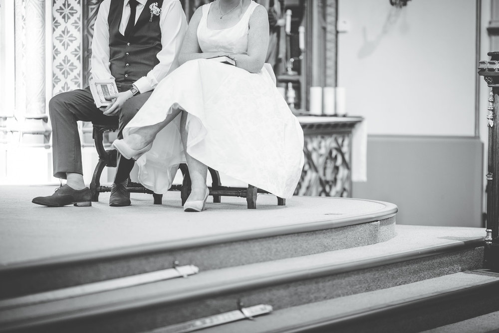 artistic black and white wedding photography - pictures within church