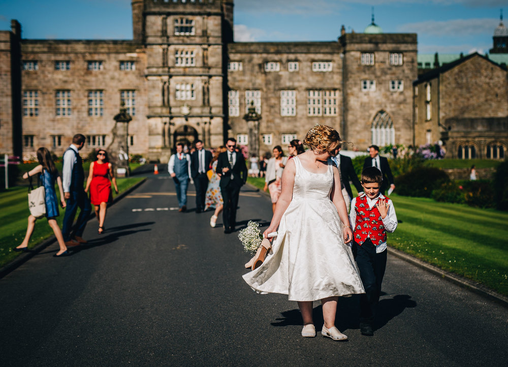 guests walk down to the wedding venue - relaxed and natural wedding photography lancashire