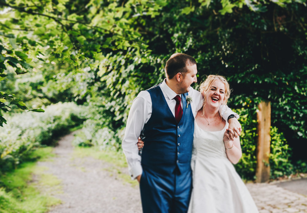 bride and groom laugh together  - relaxed natural wedding photography