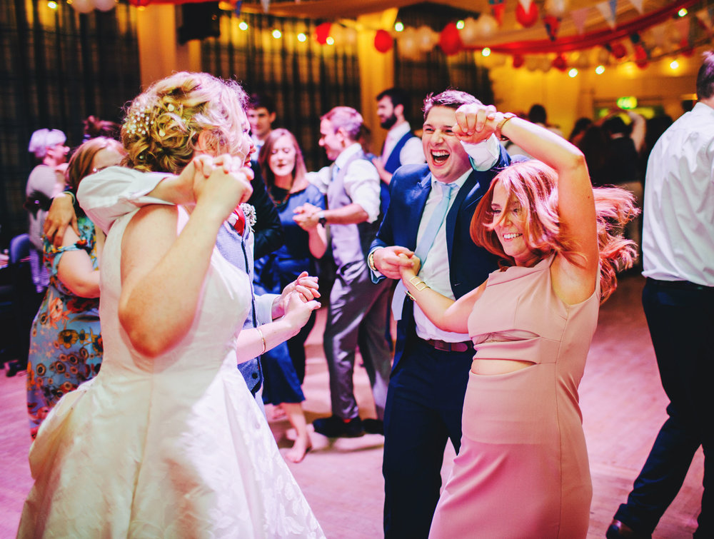 guests dance at relaxed village hall wedding