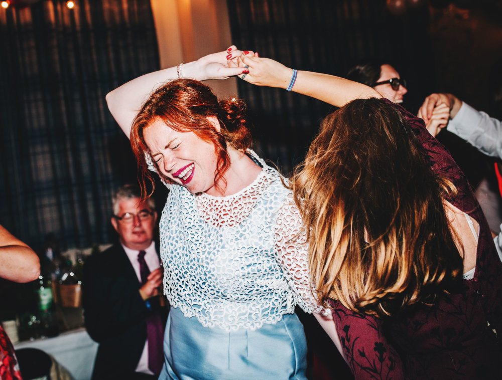 guests laugh during energetic dancing - wedding photography lancashire