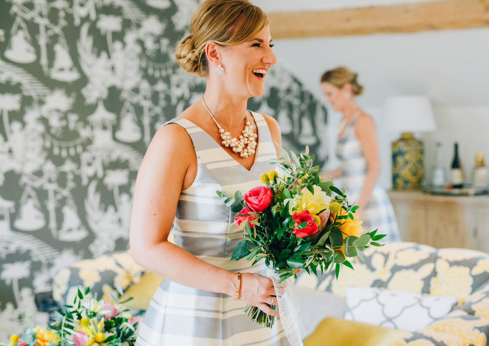 bridesmaid laughing - fun and relaxed wedding photography