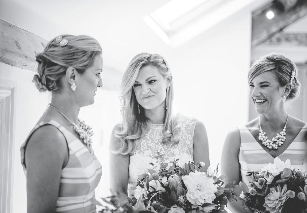 bridesmaids laugh together - lake district wedding photographer