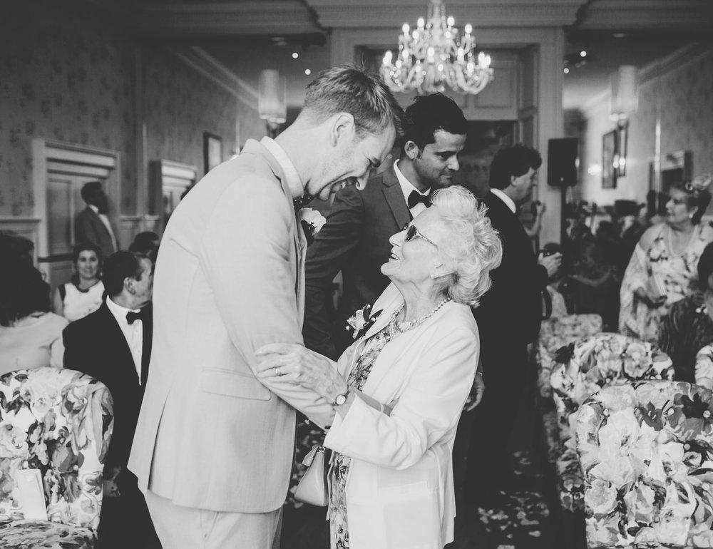 groom greets guests arriving at Swan Inn Newby Bridge