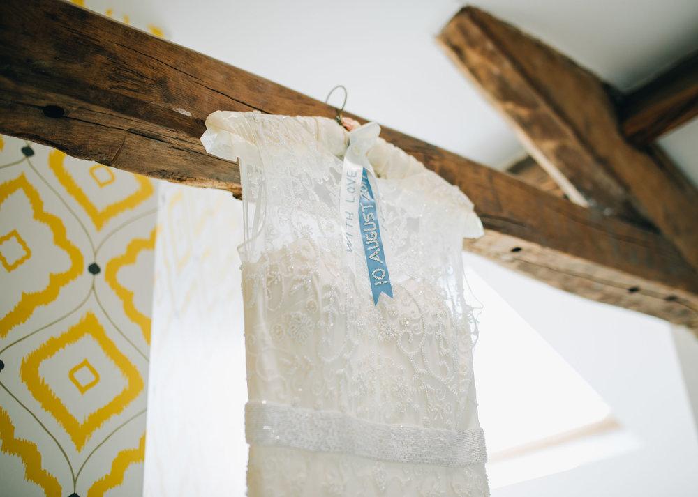 bride's dress hanging up at the swan at newby bridge