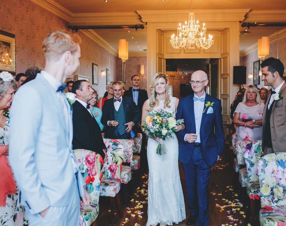 bride walks down the aisle - Lake District Wedding Photography