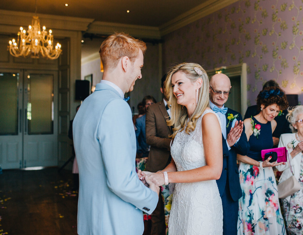 bride and groom exchange vows in the lake district