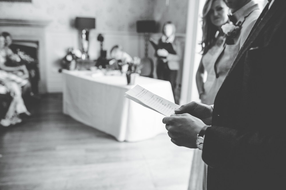 a reading at the wedding in the lakes