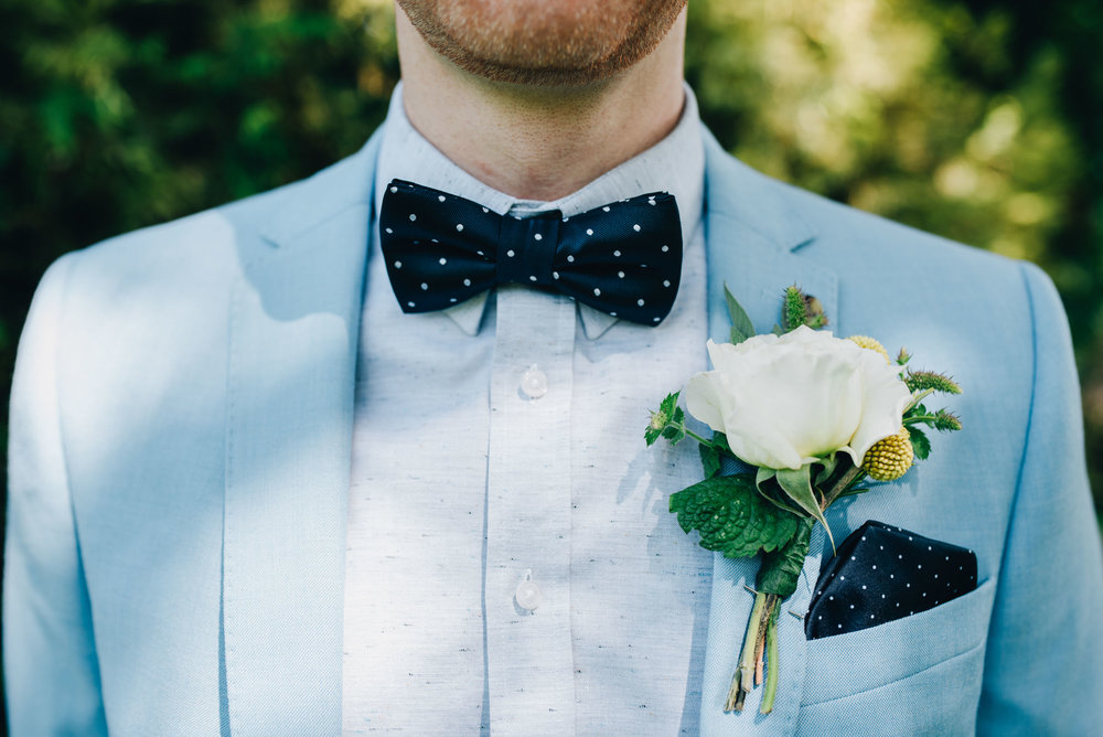 close up of button hole - stylish wedding in the lakes
