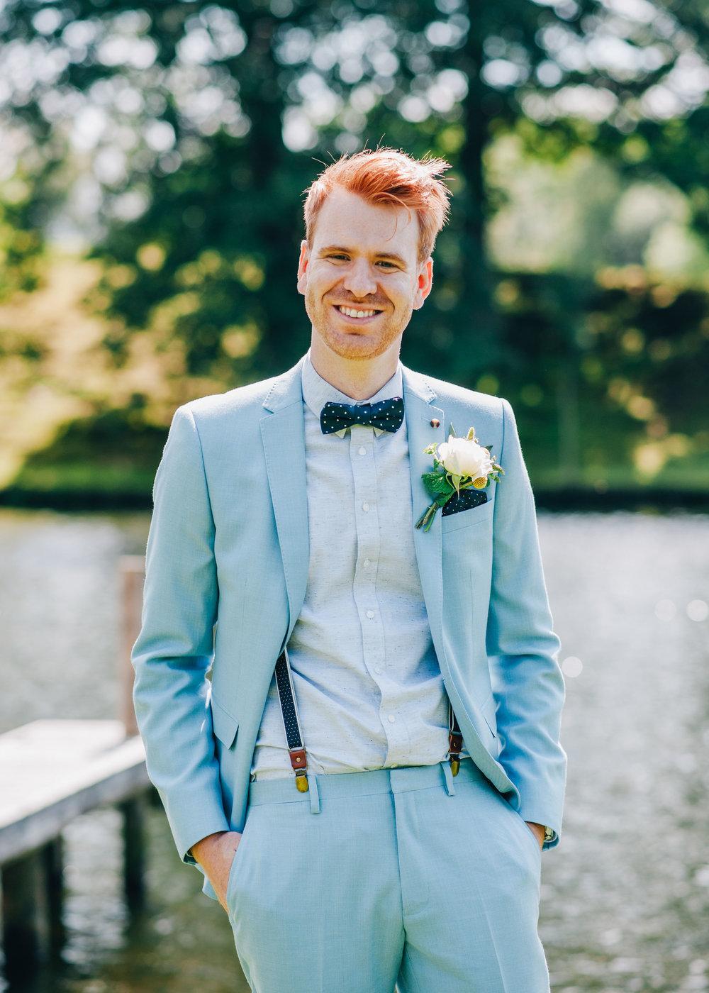 portrait of stylish groom - blue suit