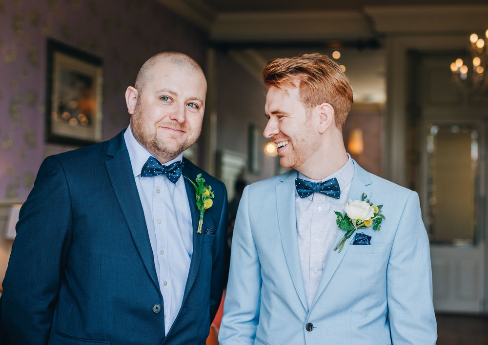 smiling groom waits for the bride to arrive - wedding photography in the lakes