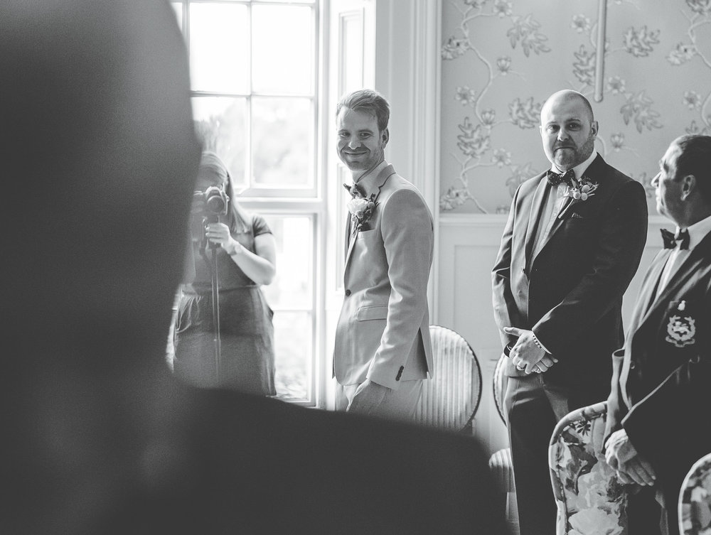 groom watches his bride arrive - documentary wedding photographer lake district