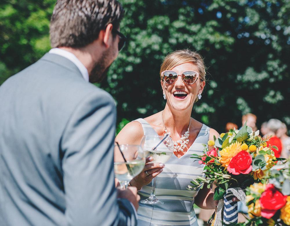 bridesmaid laughing - lake district wedding photographer