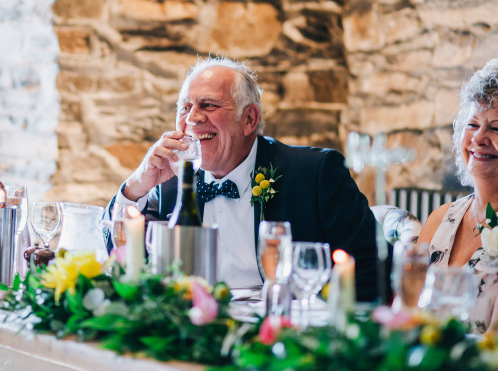 father of the groom laughing - documentary shots in the lake district