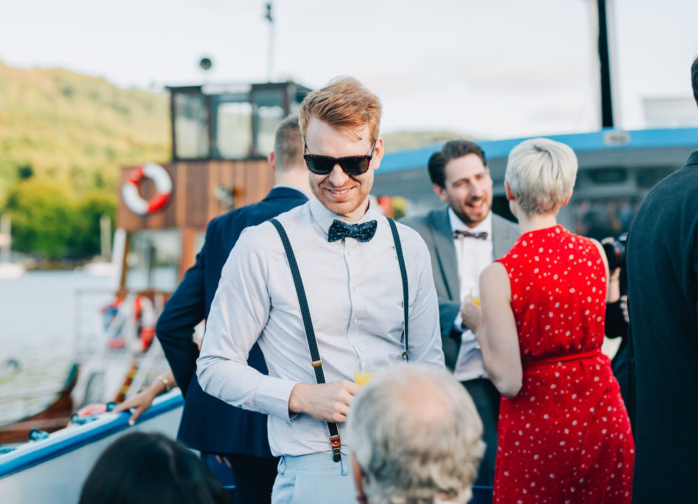 groom greets guests on the boat - wedding photography lake district