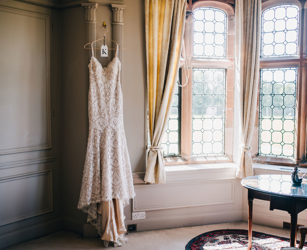 bride's dress hung up in Thornton Manor - Cheshire wedding photographer