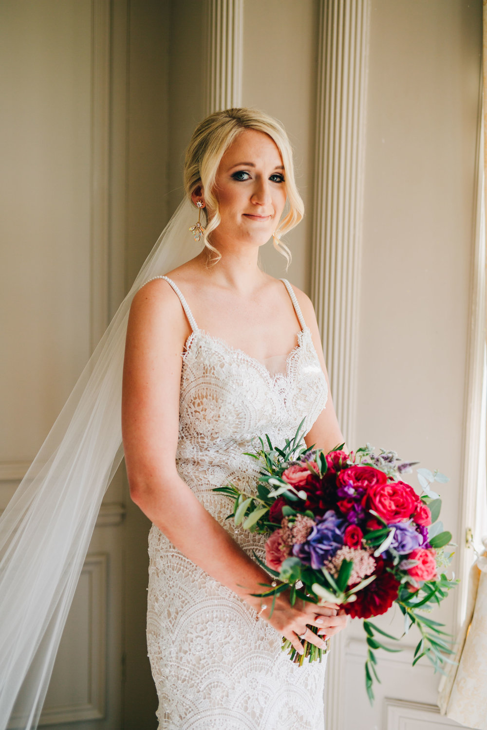 portrait of the bride in the window at Thornton Manor